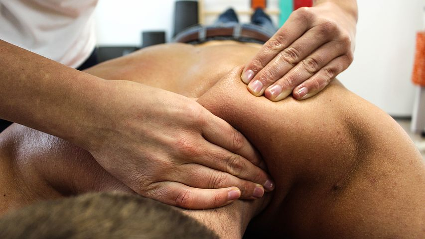 Patient getting treated by a chiro