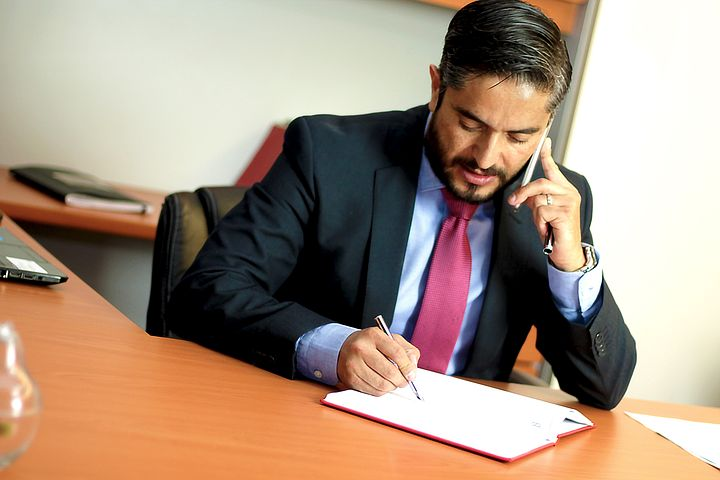 Melbourne criminal lawyer talking to a client over the phone